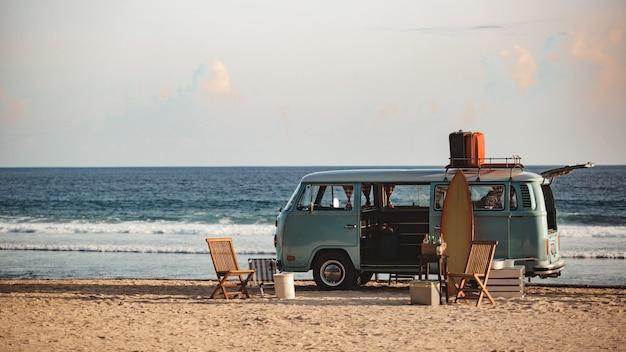 Van on the beach Free Photo