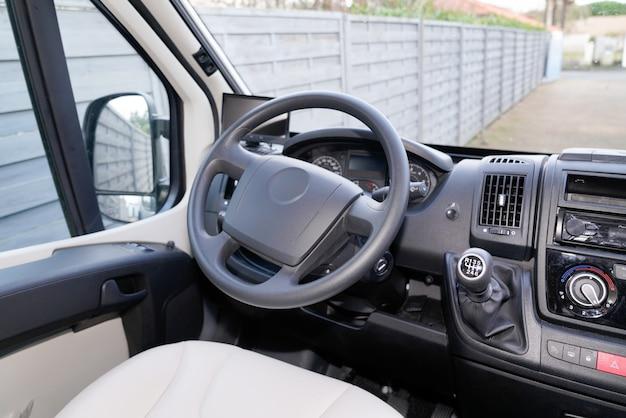 Van driver white seat dashboard black gearbox handle