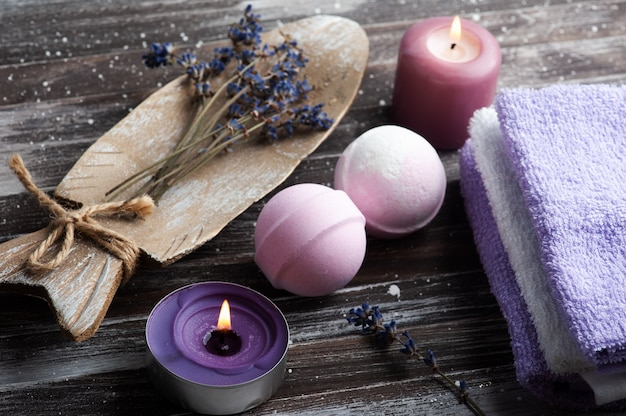 Vanilla aroma bath bombs in spa composition with dry lavender flowers and towels