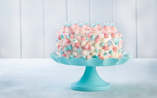Vanilla buttercream birthday cake with colorful sprinkles