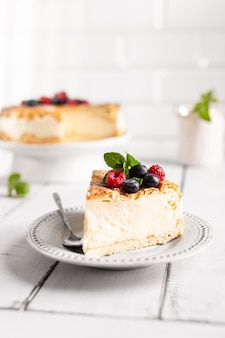 Vanilla cheesecake decorated with berries on a plate