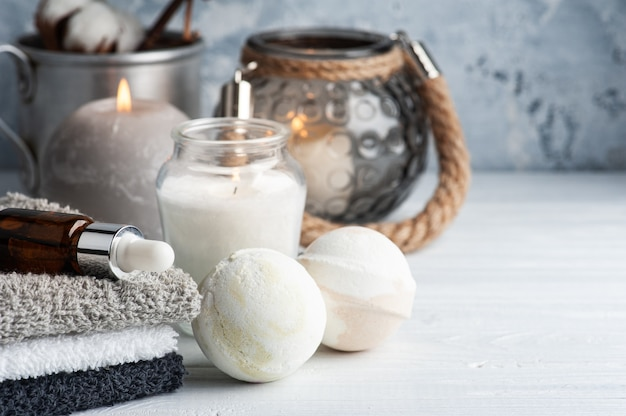 Vanilla chocolate bath bombs in spa arrengement with dry flowers and lit candles