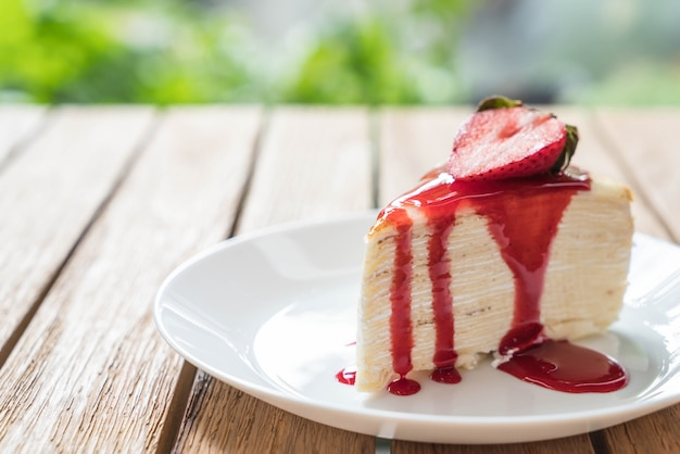 Vanilla crape cake with strawberry sauce