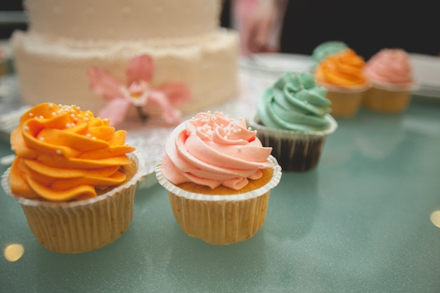 Vanilla cupcakes with bright cream glaze