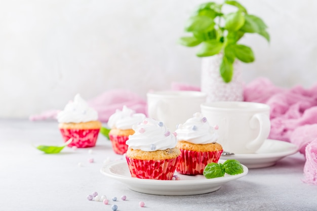 Vanilla cupcakes with white cream