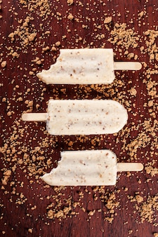 Vanilla ice cream covered with white chocolate and filled with hazelnut cream. popsicle. top view