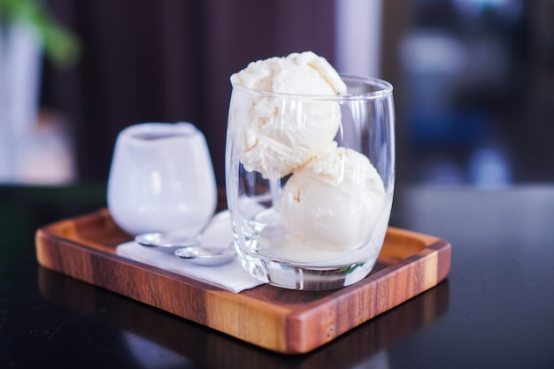 Vanilla ice cream is placed in a clear glass