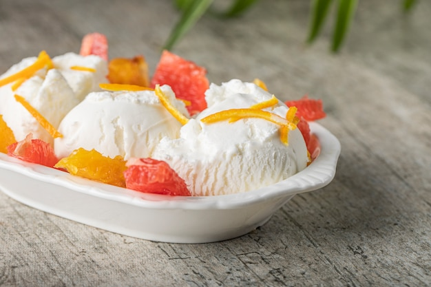 Vanilla icecream with watermelon and orange fruit pieces
