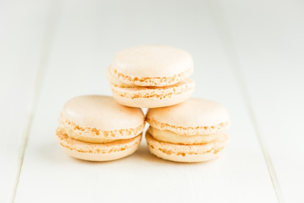 Vanilla macaroons on light background