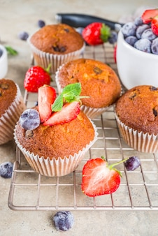 Vanilla muffins or cupcakes with berries