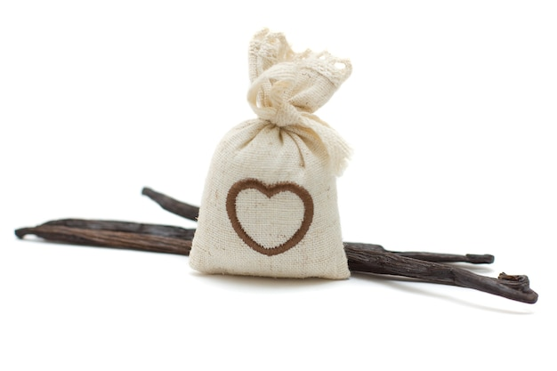 Vanilla pods and bag of aroma herbs
