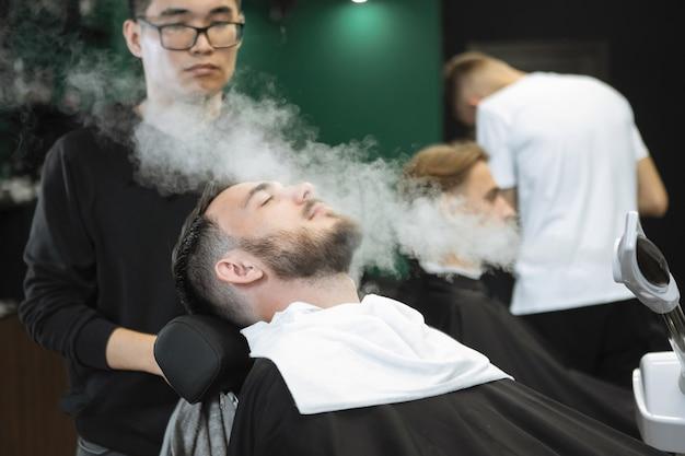 Vaporizer for the face in the hairdresser. steam beard softening in preparation for shaving