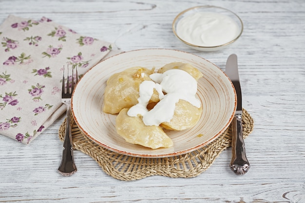 Vareniki with onion and sour cream