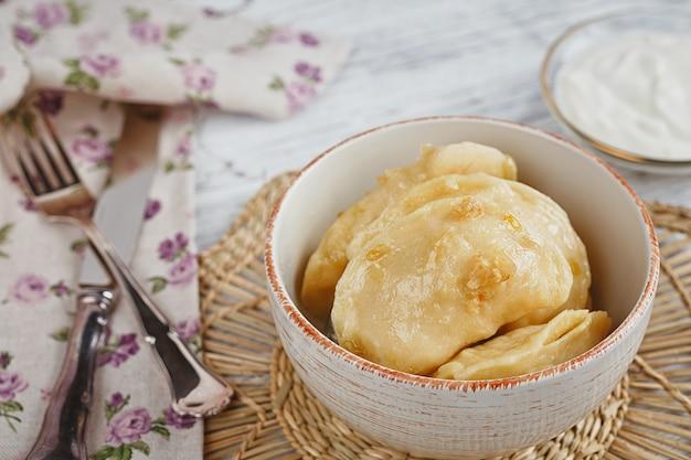 Vareniki with onion and sour cream