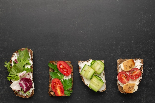 Variants of traditional danish open sandwiches on rye bread for breakfast