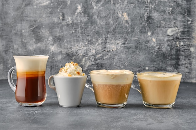 Variation of coffee drinks on shabby background