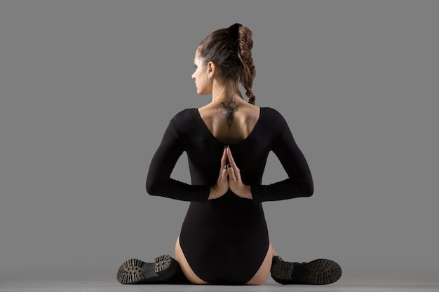 Variation of gomukhasana yoga pose