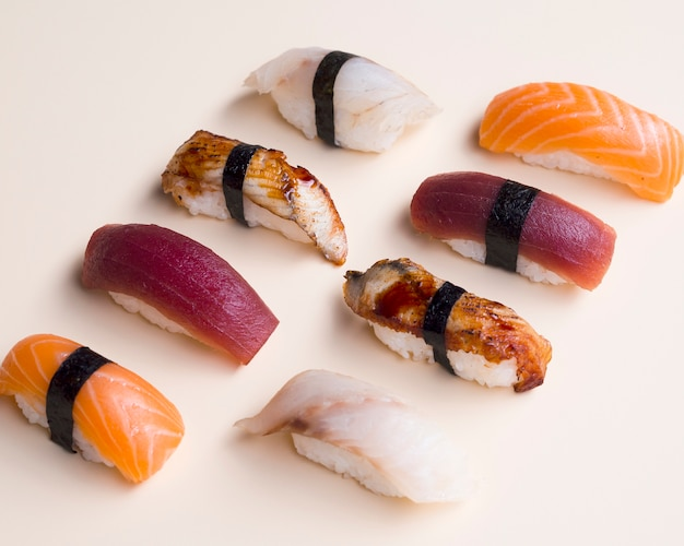 Variation of sushi on a white table