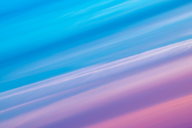 Varicolored striped surreal sky with shades of blue, cyan, cobalt, pink, purple, magenta colors.