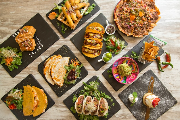 Varied mexican food viewed from above.