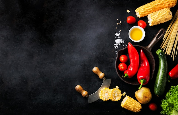 Varied vegetables placed on a black table