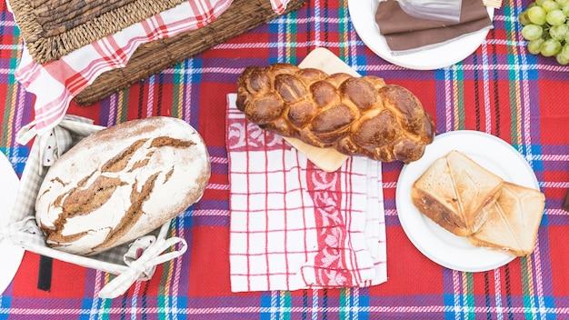 Varieties of fresh breads on table