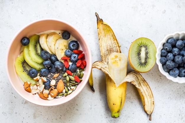 Varieties of fruits and nuts on greek yogurt