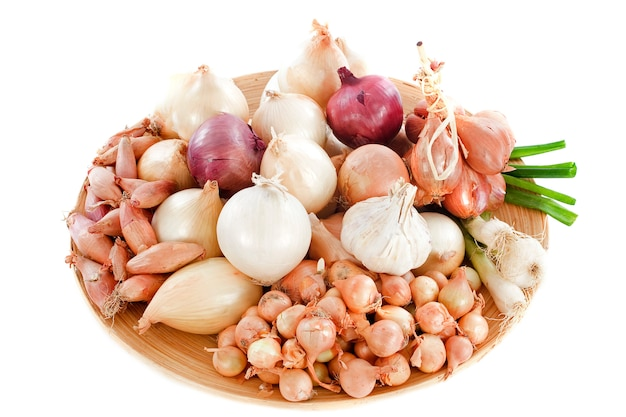 Varieties of onions on cutting board