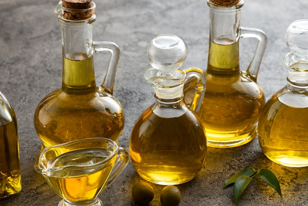 Variety of bottles filled with olive oil