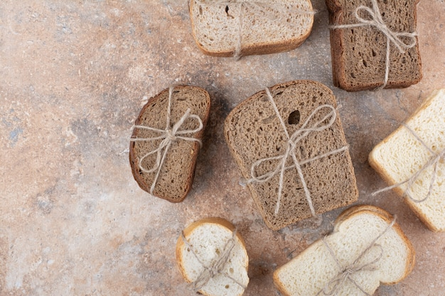 Variety of bread stacks on marble background