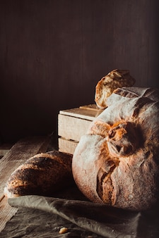Variety of breads on vintage scene