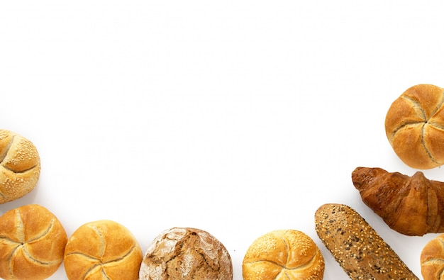 Variety for breakfast bread products from bakery, top view isolated on white background