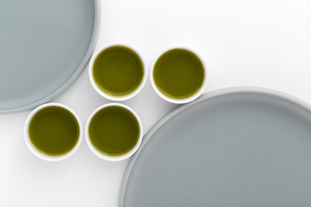 Variety of ceramic cups with matcha tea
