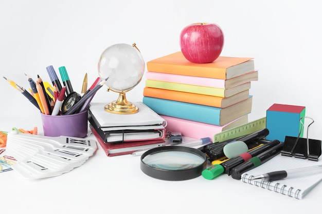 Variety of colorful school supplies on a white background.
