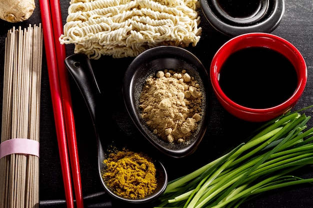 Variety defferent many ingredients for cooking tasty oriental asian food. top view with copy space. dark background. above. toning.