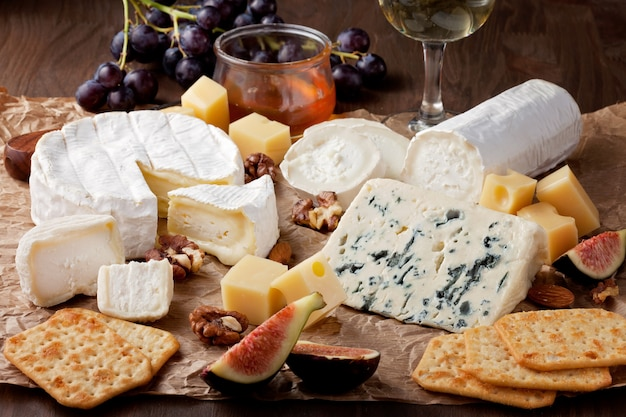 Variety of different cheese with wine