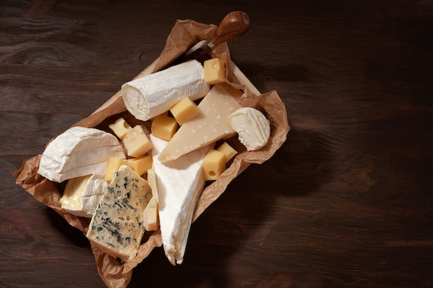 Variety of different cheese with wine.