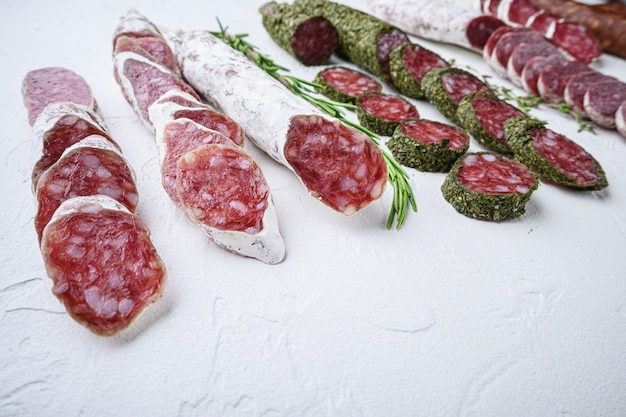 Variety of dry cured fuet and chorizo salami sausages