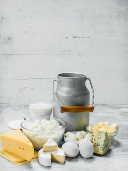 Variety of fresh dairy products on rustic table.