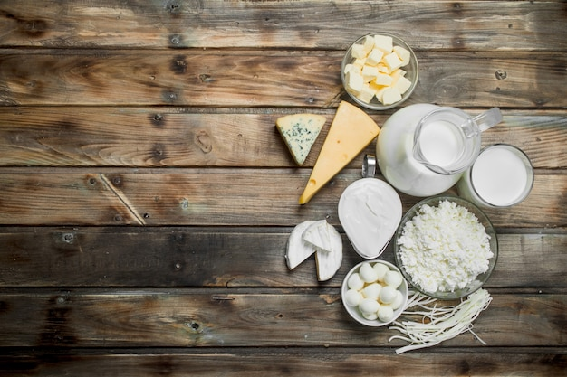 Variety of fresh dairy products on a wooden table.