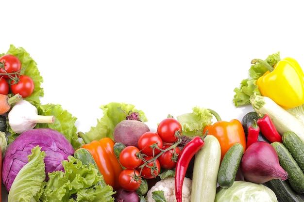Variety of fresh vegetables on white background