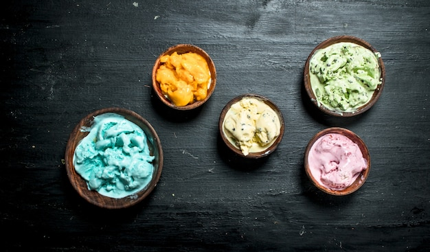 Variety of fruit ice cream in a bowl on the black chalkboard