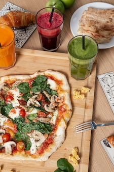 Variety of healthy food, smoothies and pastries.