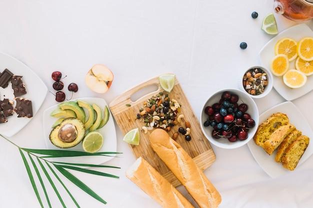 Variety of healthy fresh breakfast on white backdrop