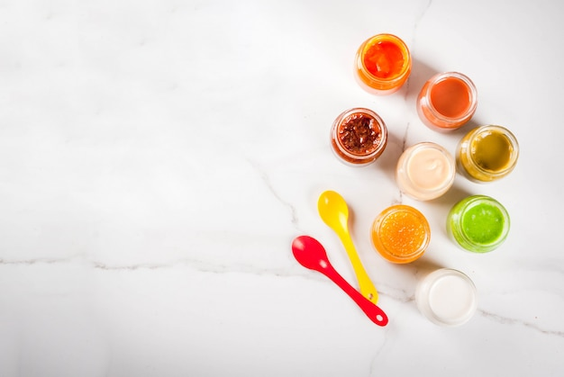 Variety of homemade baby vegetable and fruit puree