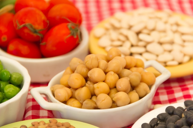 Variety of kitchen ingredients with fresh and dried legumes