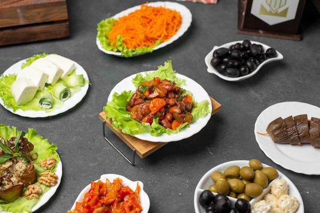 Variety of marinated foods on the table with traditional turshu govurma.