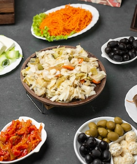 Variety of marinated foods on the table.