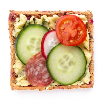 Variety of mini sandwiches with cream cheese, vegetables and salami