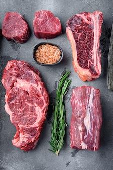 Набор сырых мясных стейков блэк ангус прайм, томагавк, косточка, клубный стейк